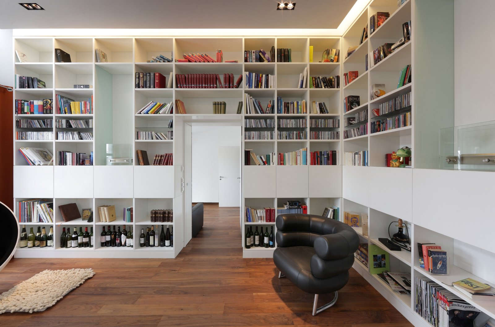 Office, Library Room Type, Bookcase, Storage, Shelves, Lamps, Medium Hardwood Floor, Desk, and Chair  Penthouse Apartment in Bielefeld