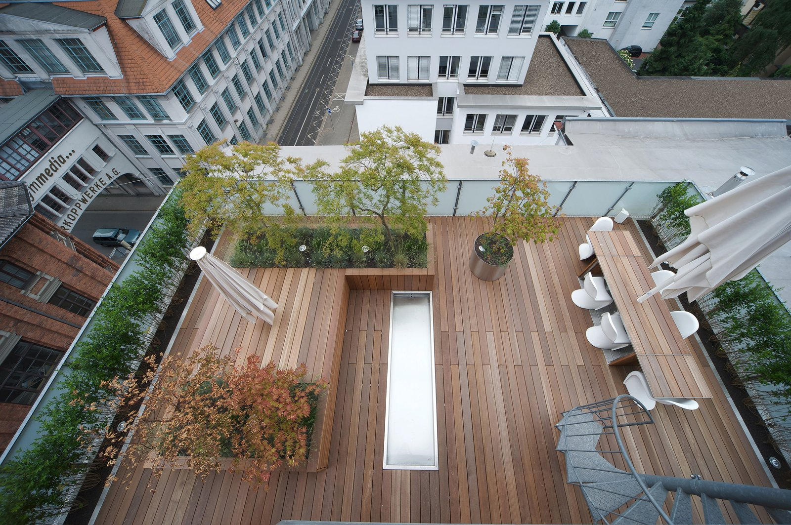 Outdoor, Garden, Rooftop, Trees, Shrubs, Gardens, Wood Patio, Porch, Deck, Landscape Lighting, and Grass  Penthouse Apartment in Bielefeld