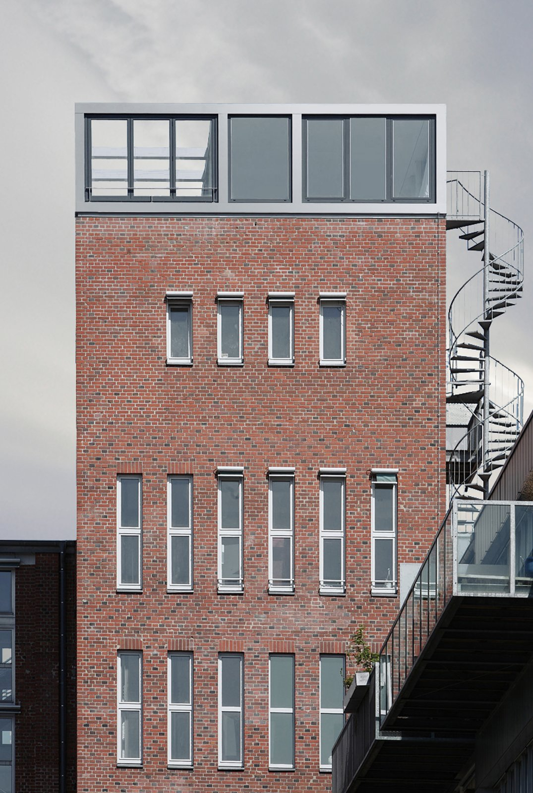 Exterior, Apartment Building Type, Brick Siding Material, and Flat RoofLine  Penthouse Apartment in Bielefeld