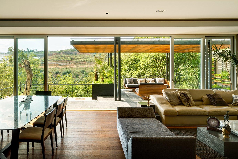 Living Room and Sofa  Villa Jardín by ASP Arquitectura Sergio Portillo