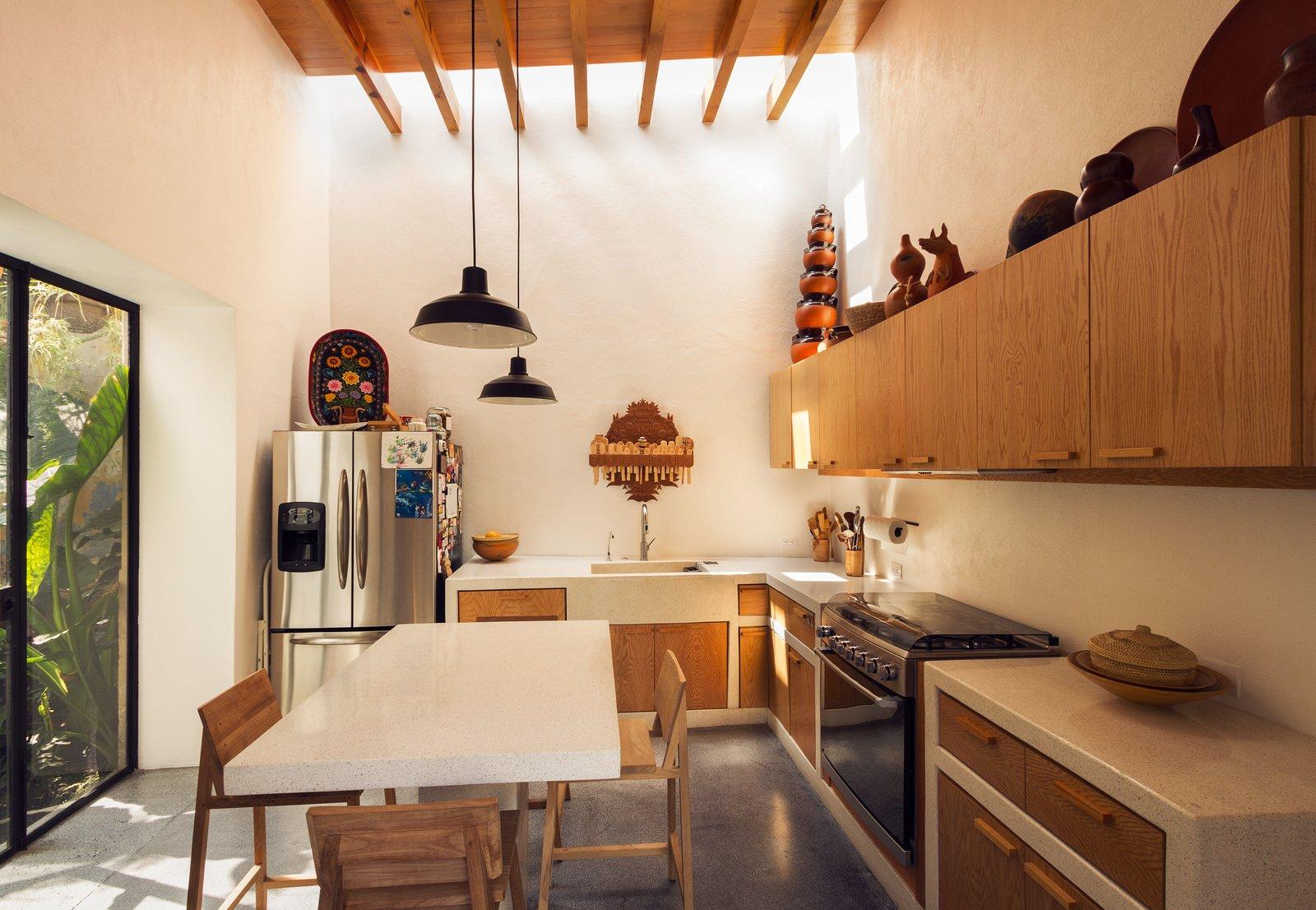 Kitchen, Refrigerator, Wood Cabinet, and Accent Lighting  Veramendi House