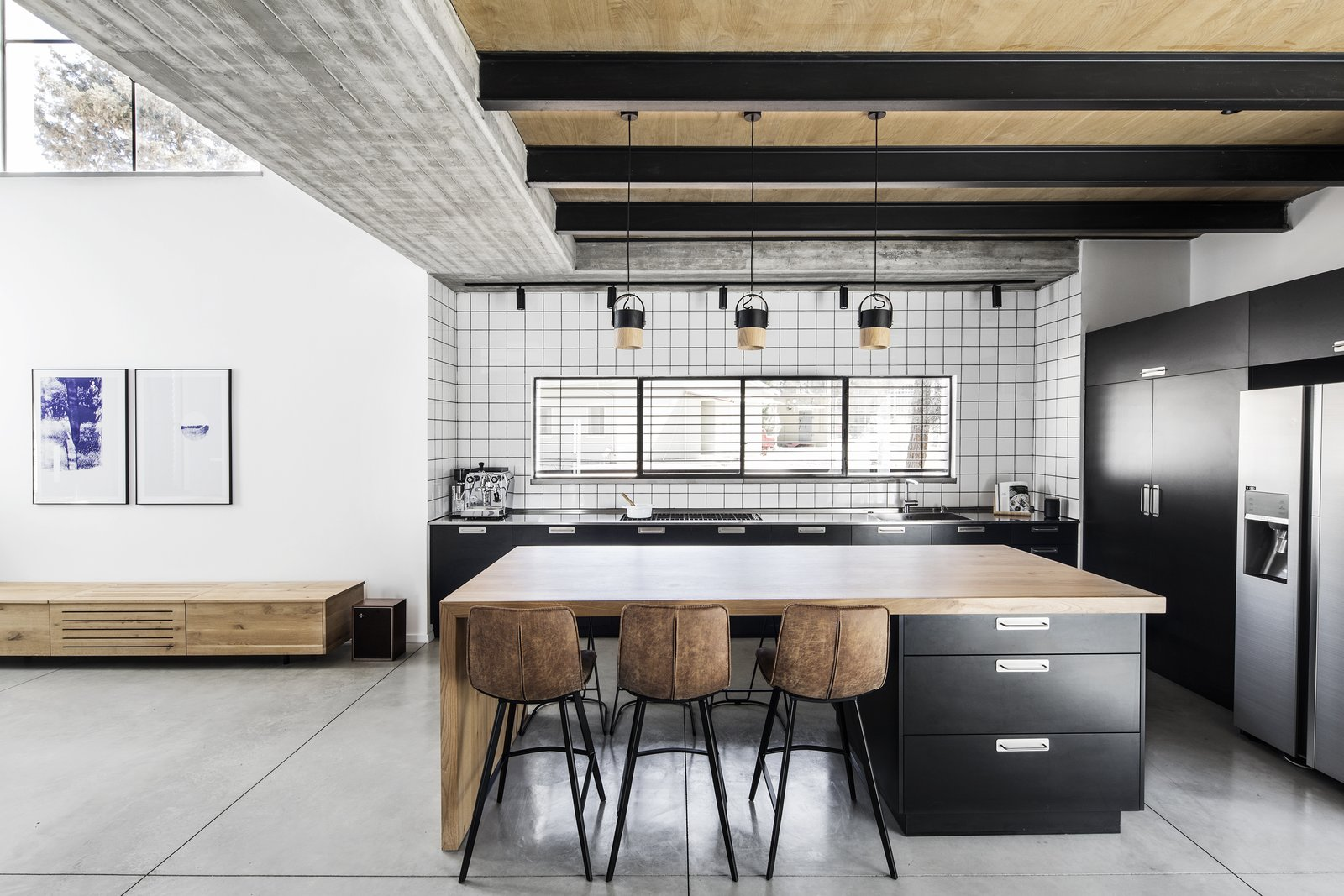 Kitchen, Refrigerator, Cooktops, Dishwasher, Metal Counter, Colorful Cabinet, Concrete Floor, Ceramic Tile Backsplashe, Ceiling Lighting, Pendant Lighting, and Undermount Sink  Nir Am House by Shir Shtaigman