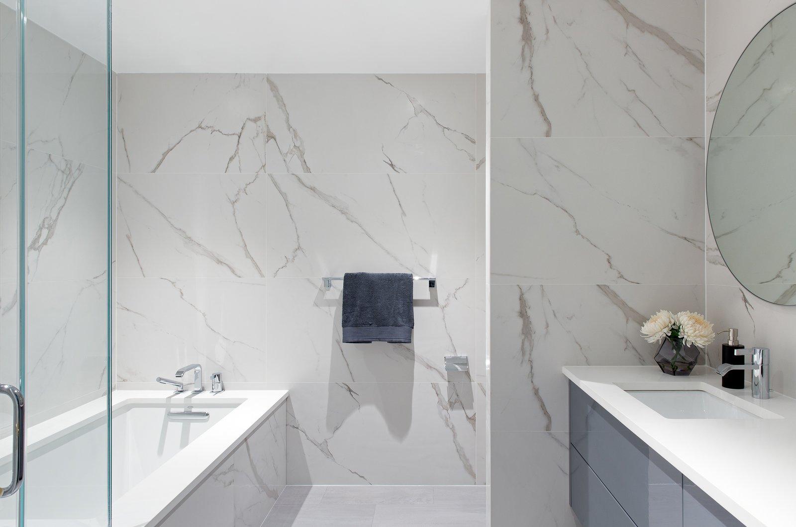 Bath Room, Enclosed Shower, Stone Counter, Engineered Quartz Counter, Porcelain Tile Floor, Undermount Tub, Soaking Tub, Marble Wall, Undermount Sink, and Porcelain Tile Wall  Boerum Hill Brownstone