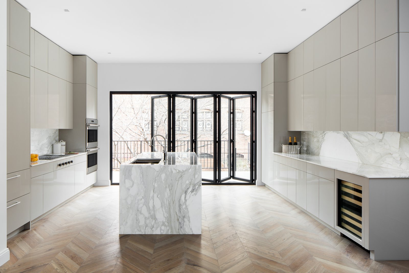 Kitchen, Colorful, Refrigerator, Marble, Dishwasher, Ceiling, Wall Oven, Cooktops, Medium Hardwood, Stone Slab, Wine Cooler, Open, Undermount, and Recessed  Best Kitchen Wall Oven Ceiling Open Undermount Stone Slab Photos from Boerum Hill Brownstone