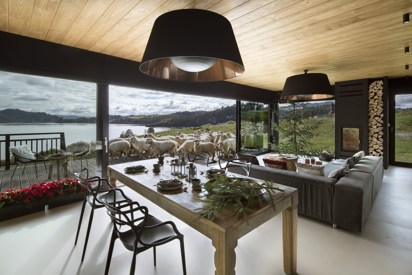 Living Room, Chair, Sofa, Concrete Floor, and Wall Lighting  Mountain Cottage