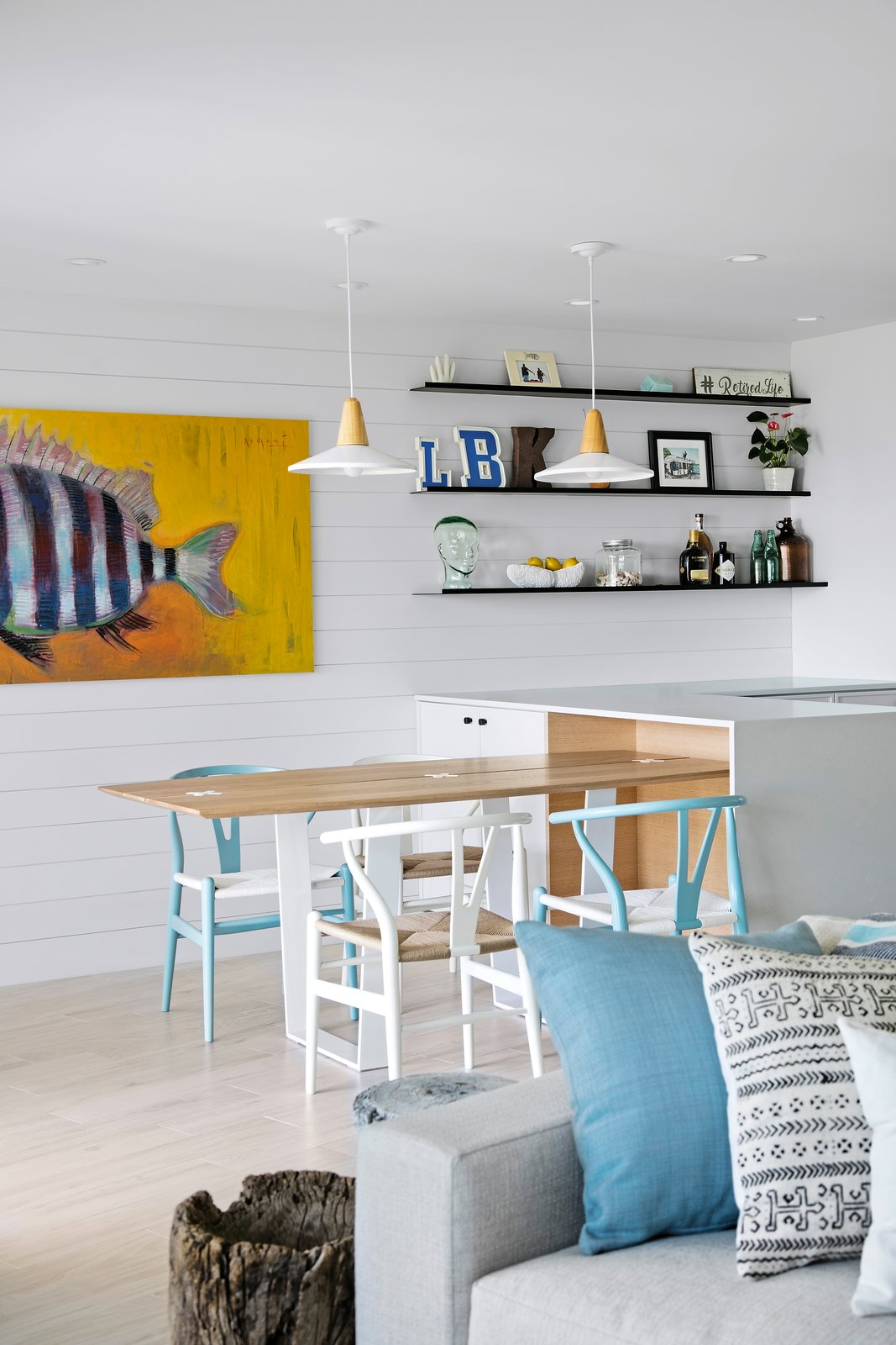 Dining Room, Ceramic Tile Floor, Accent Lighting, Table, Recessed Lighting, Chair, Pendant Lighting, and Ceiling Lighting  Calypso Blue by Leader Design Studio