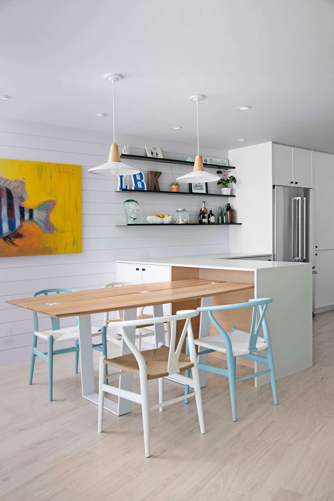 Chair, Accent Lighting, Ceramic Tile Floor, Pendant Lighting, Dining Room, Ceiling Lighting, and Recessed Lighting  Calypso Blue by Leader Design Studio