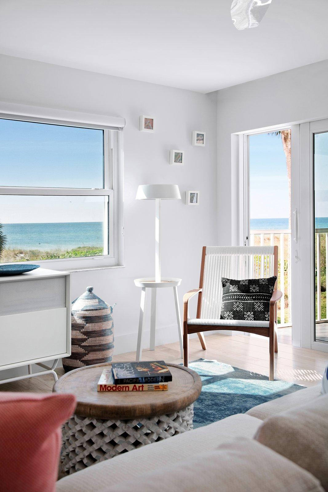 Living Room, Ceramic Tile Floor, Ceiling Lighting, Chair, Floor Lighting, Sectional, and Accent Lighting  Calypso Blue by Leader Design Studio