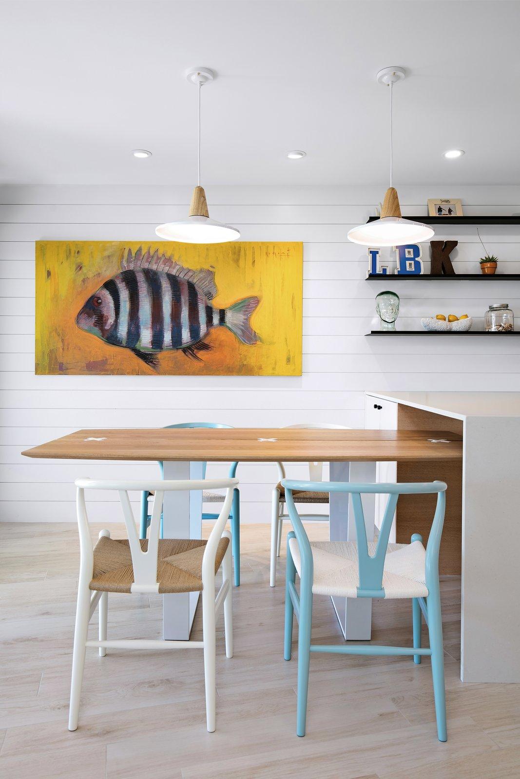 Dining Room, Accent Lighting, Pendant Lighting, Ceiling Lighting, Chair, Recessed Lighting, and Ceramic Tile Floor  Calypso Blue by Leader Design Studio