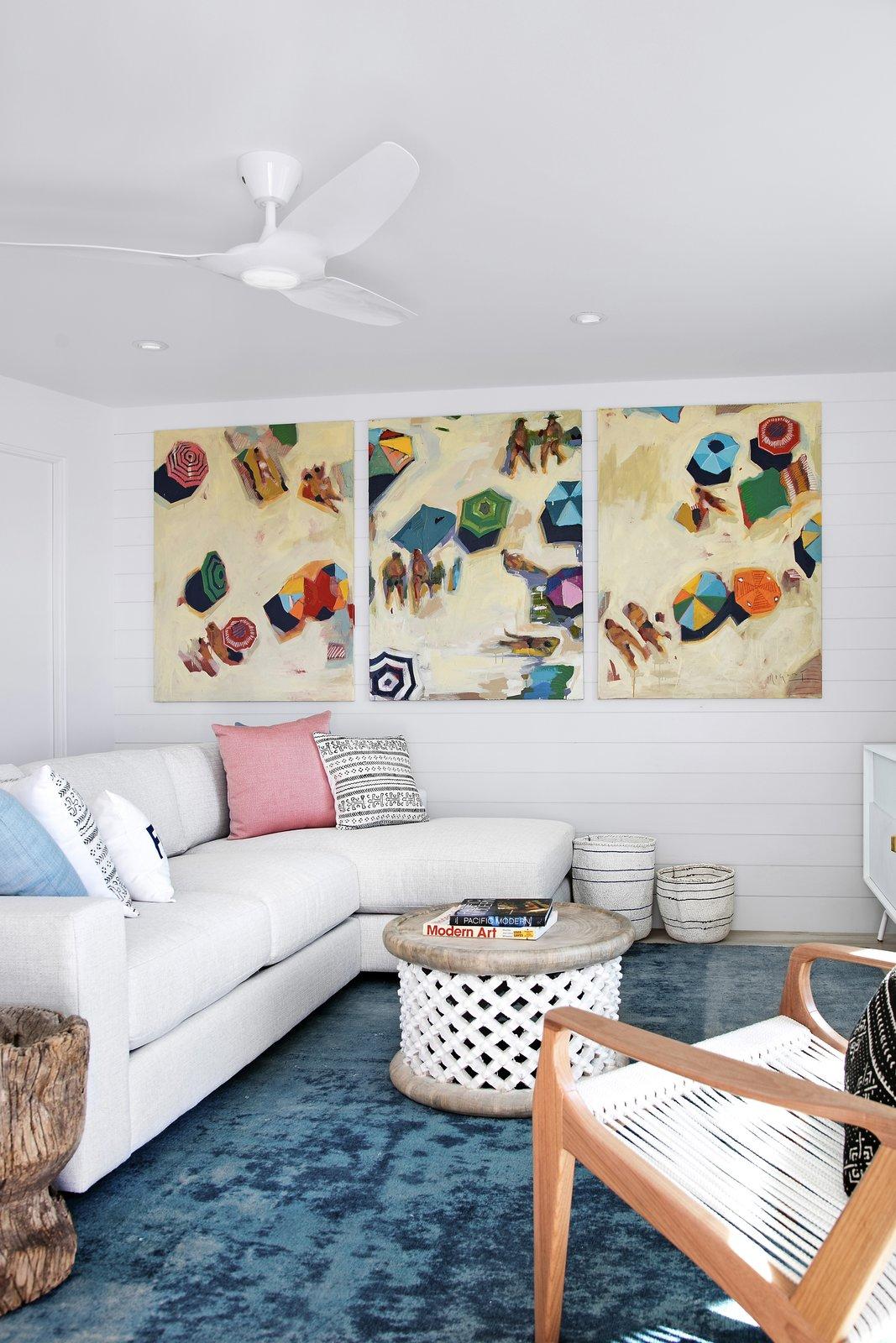 Living Room, Sectional, Porcelain Tile Floor, and Ceiling Lighting  Calypso Blue by Leader Design Studio