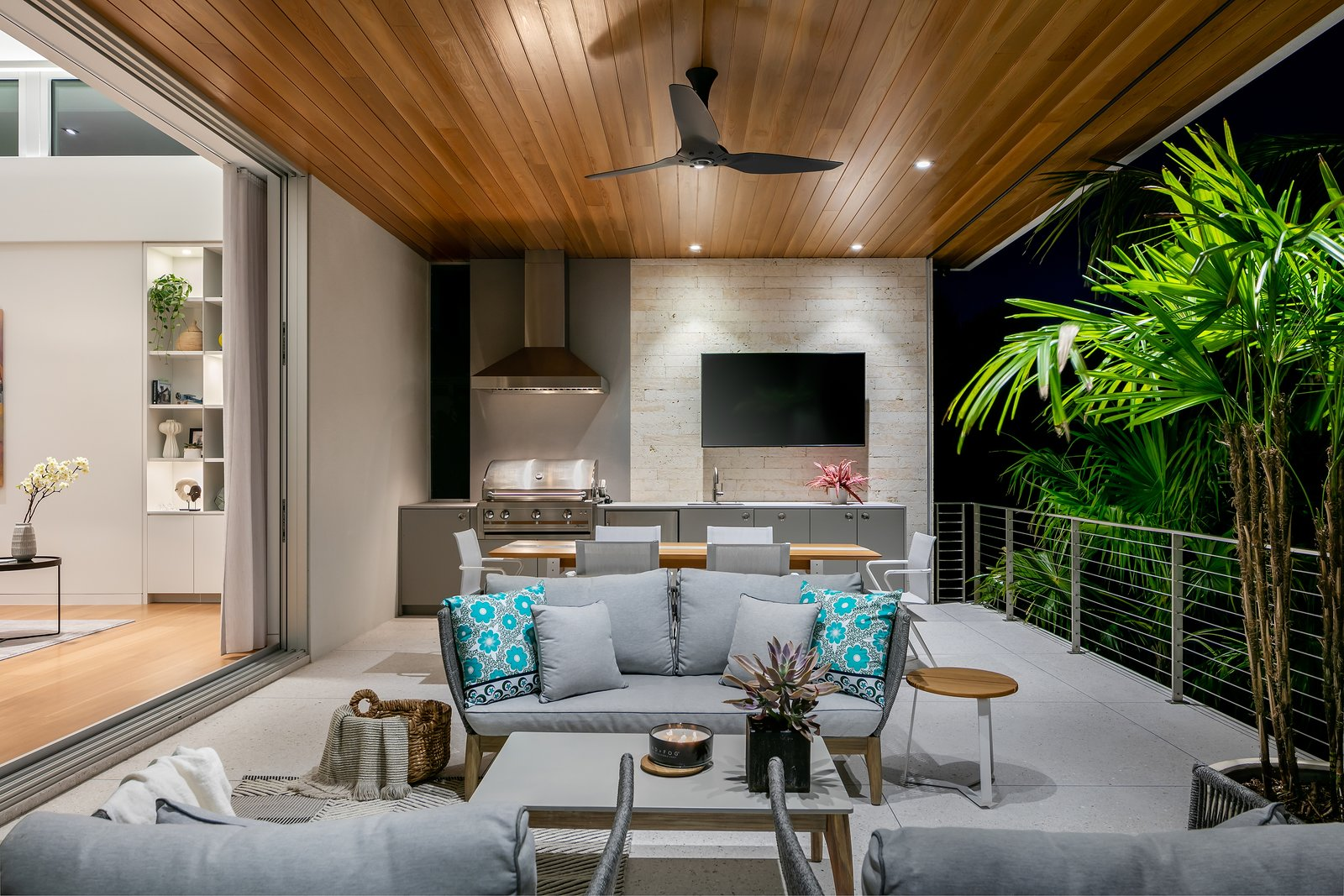 Outdoor, Back Yard, Shrubs, Horizontal Fences, Wall, Trees, Large Patio, Porch, Deck, Stone Fences, Wall, Planters Patio, Porch, Deck, and Concrete Patio, Porch, Deck  Bayview House by Leader Design Studio