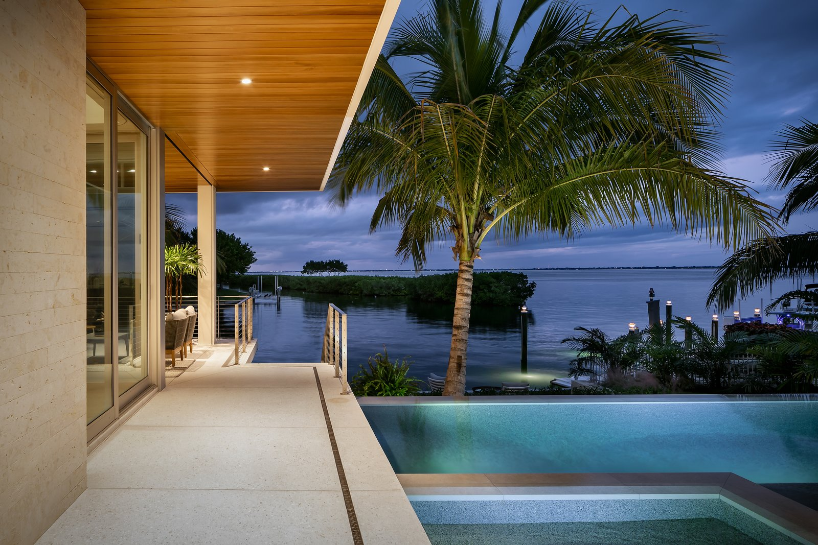 Outdoor, Large Patio, Porch, Deck, Trees, Back Yard, Infinity Pools, Tubs, Shower, Walkways, Wood Patio, Porch, Deck, Large Pools, Tubs, Shower, Hot Tub Pools, Tubs, Shower, Concrete Patio, Porch, Deck, Stone Fences, Wall, Swimming Pools, Tubs, Shower, Horizontal Fences, Wall, and Salt Water Pools, Tubs, Shower  Bayview House by Leader Design Studio