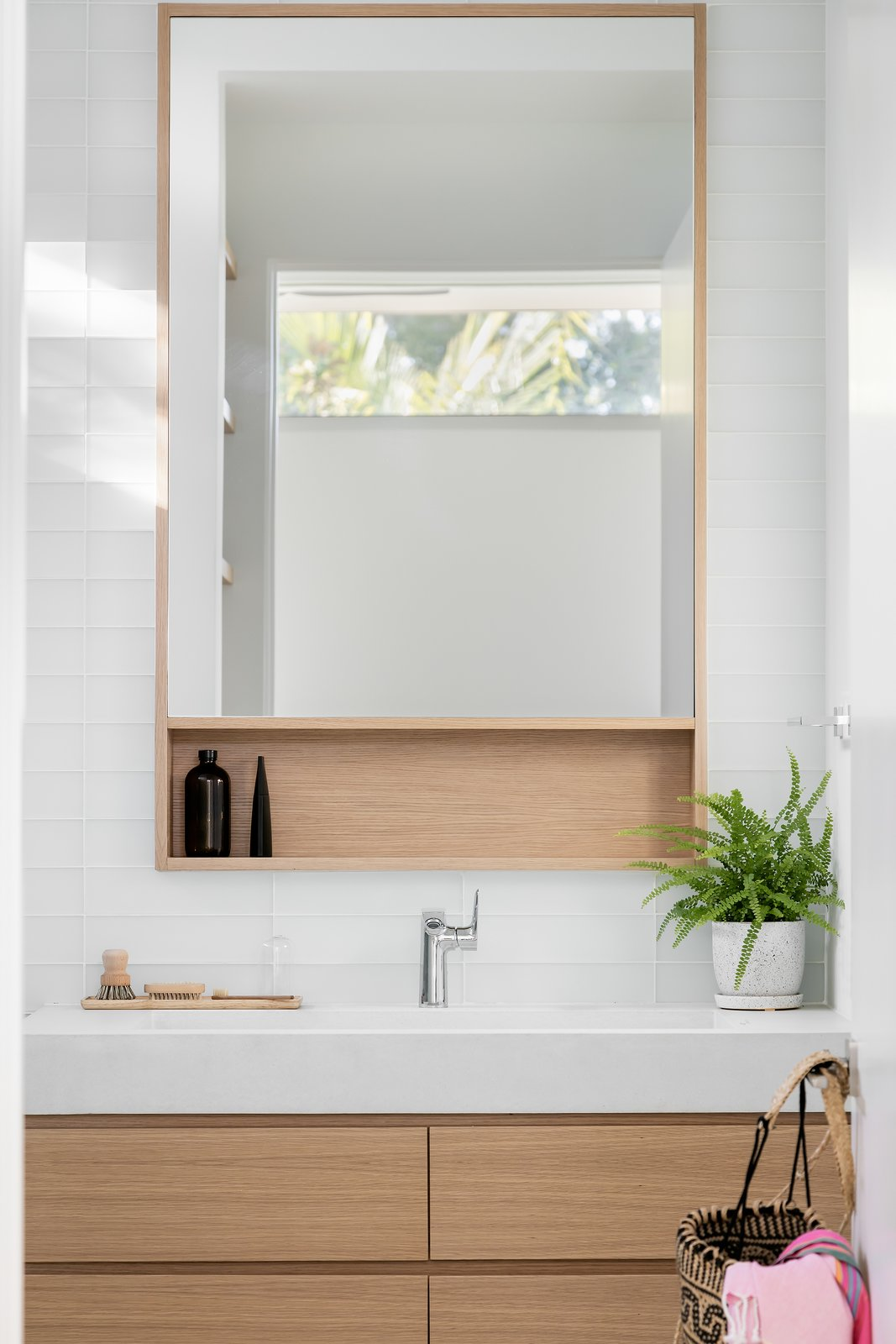 Bath Room, Concrete Counter, Porcelain Tile Floor, One Piece Toilet, Recessed Lighting, Glass Tile Wall, Ceiling Lighting, Open Shower, and Wall Mount Sink  Bayview House by Leader Design Studio