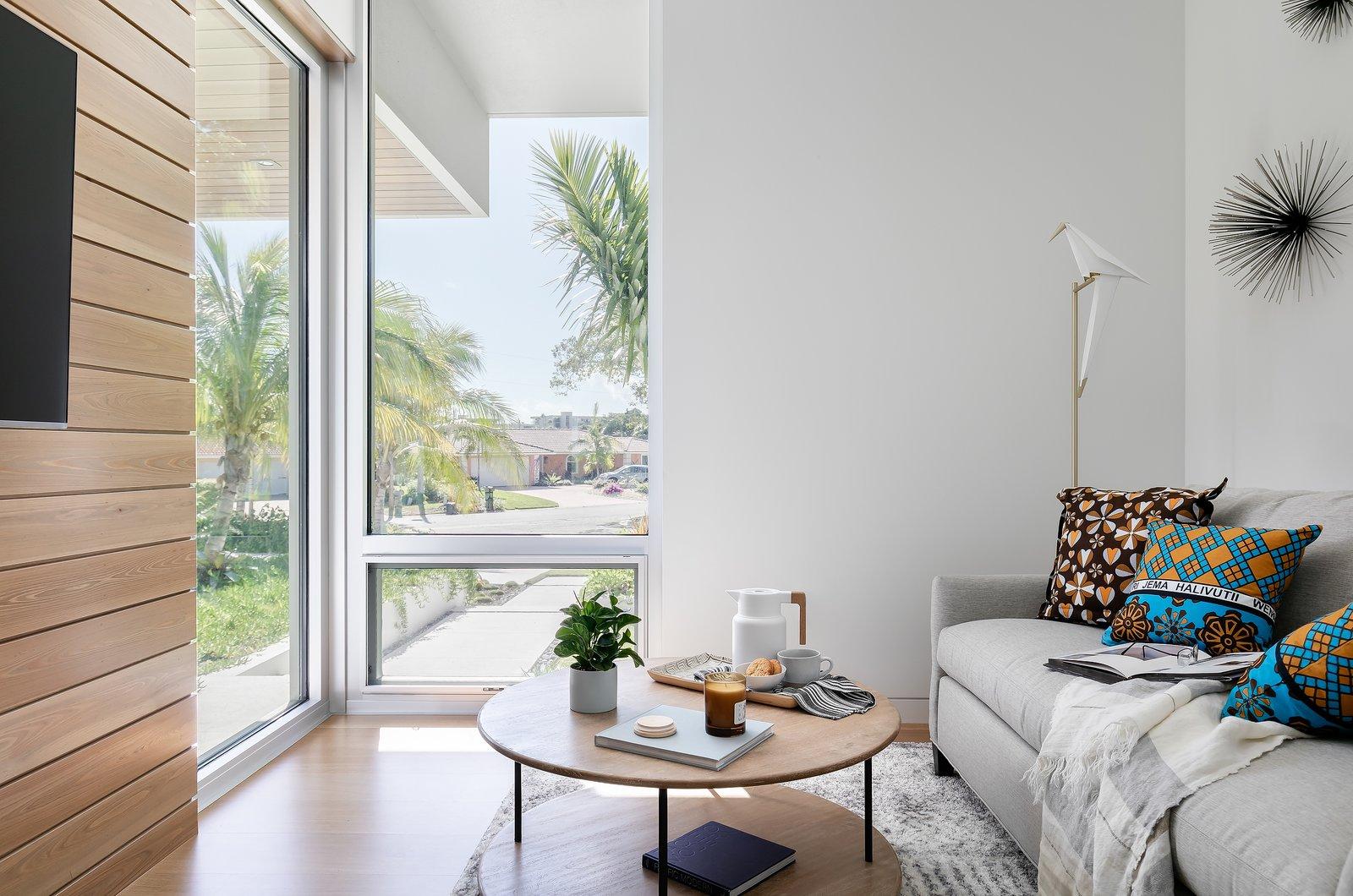 Living Room, Sofa, Coffee Tables, Lamps, Medium Hardwood Floor, and Floor Lighting  Bayview House by Leader Design Studio