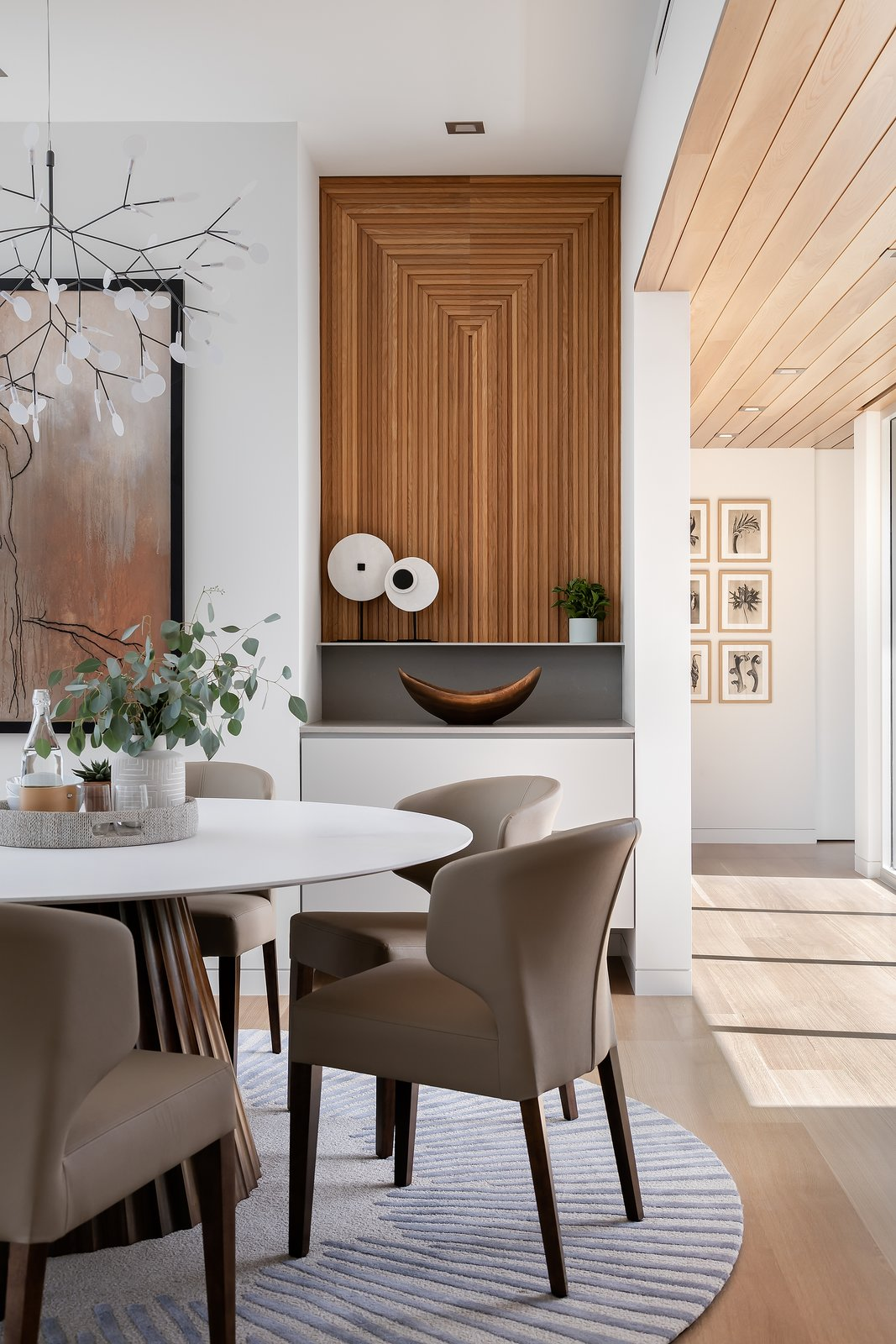 Dining Room, Accent Lighting, Ceiling Lighting, Medium Hardwood Floor, Pendant Lighting, Table, Recessed Lighting, Storage, and Chair  Bayview House by Leader Design Studio