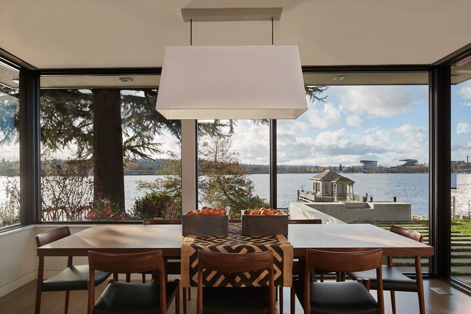 Dining Room, Table, Chair, Pendant Lighting, and Light Hardwood Floor  Union Bay Residence by NB Design Group
