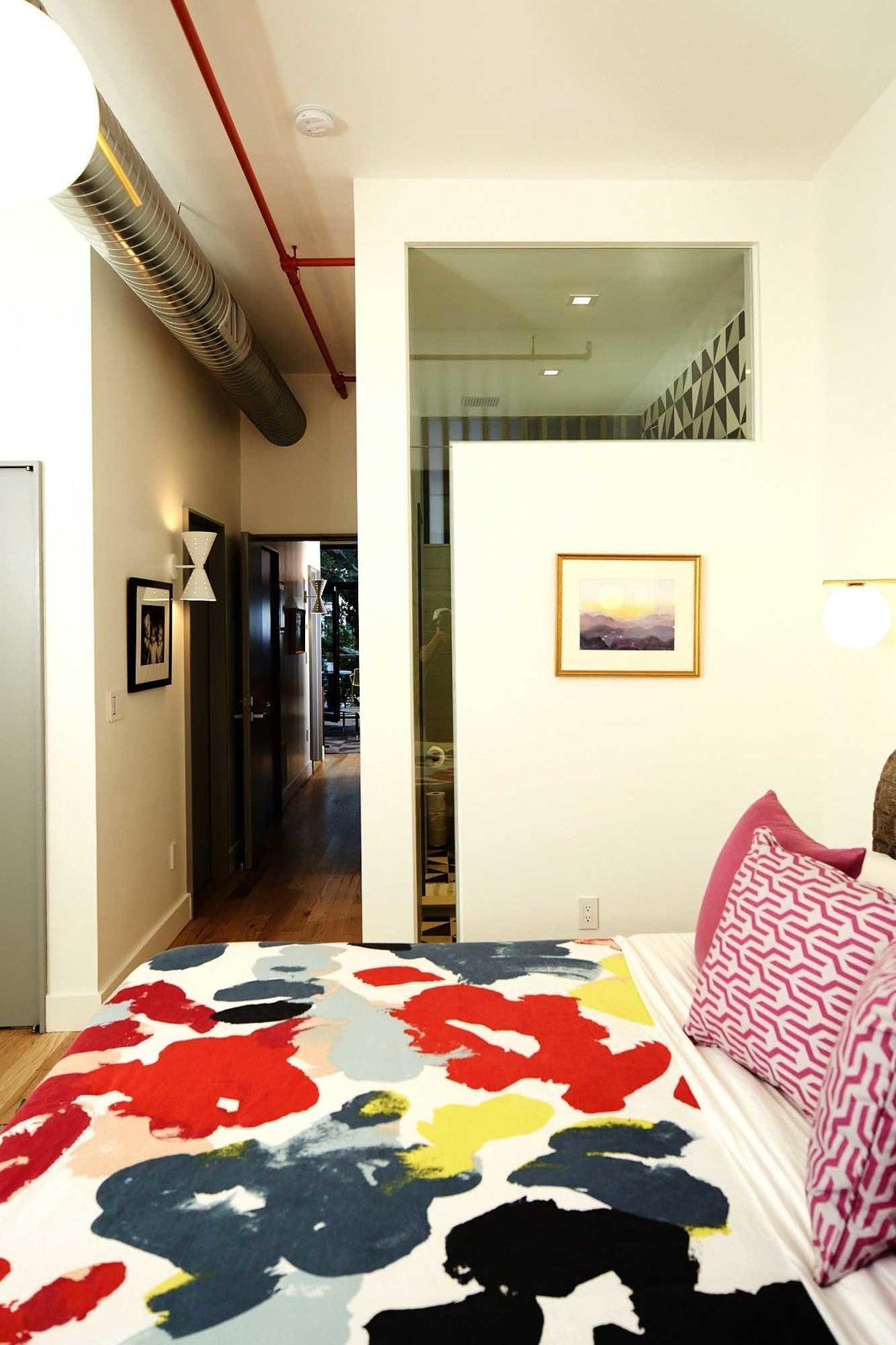 Bedroom, Medium Hardwood Floor, and Bed  Harlem Townhouse by Opera Studio Architecture