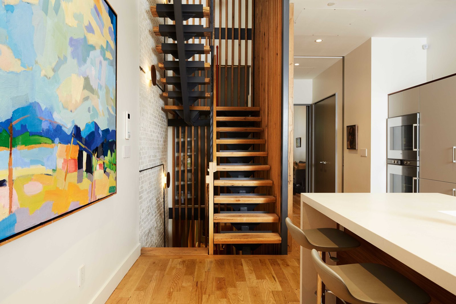 Staircase, Metal Tread, Wood Tread, and Wood Railing  Harlem Townhouse by Opera Studio Architecture