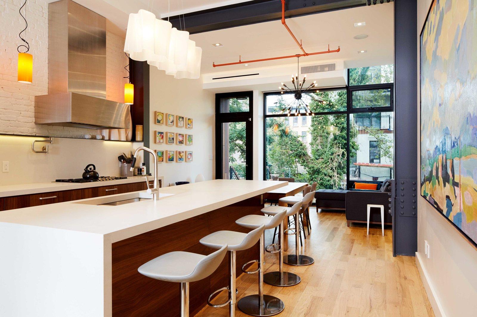 Kitchen, Undermount, Engineered Quartz, Pendant, Range, White, Range Hood, and Medium Hardwood  Best Kitchen Engineered Quartz Medium Hardwood Photos from Harlem Townhouse
