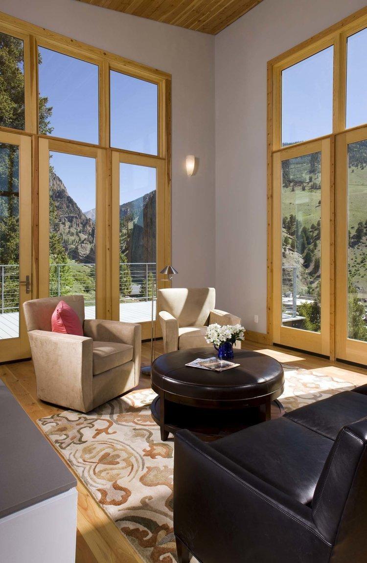 Living Room, Sofa, Ottomans, Chair, Lamps, Floor Lighting, Light Hardwood Floor, and Wall Lighting  Cliff House
