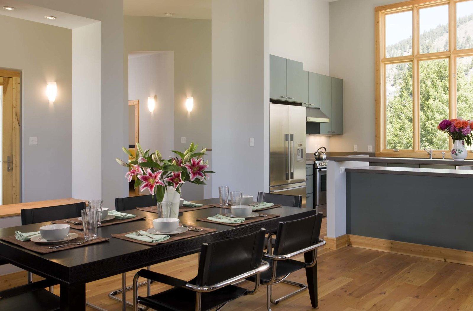 Dining Room, Bar, Table, Wall Lighting, Chair, and Light Hardwood Floor  Cliff House