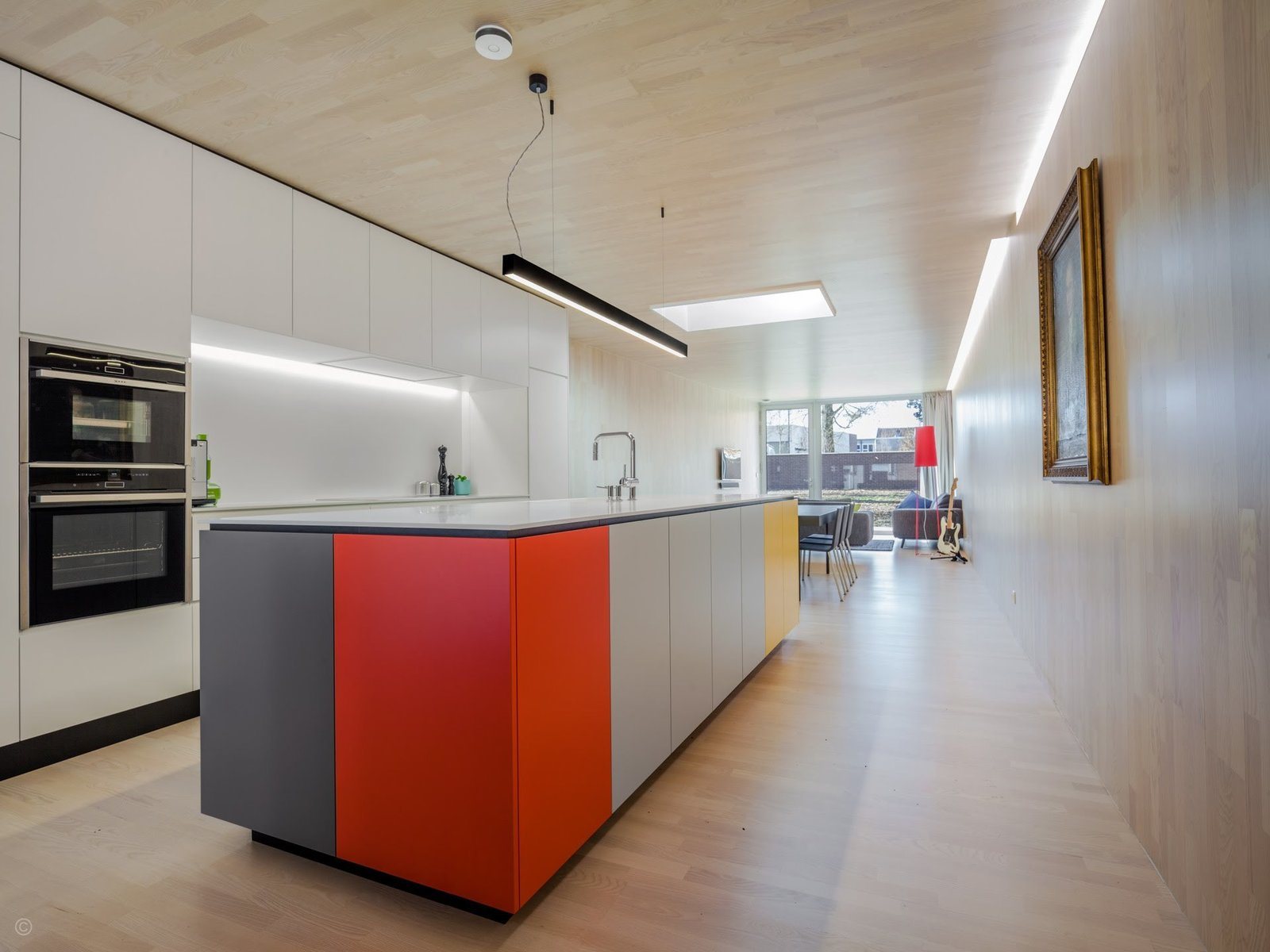 Kitchen, Recessed Lighting, Colorful Cabinet, Pendant Lighting, Light Hardwood Floor, White Cabinet, Cooktops, Dishwasher, Refrigerator, and Drop In Sink  Private House and Architecture Office