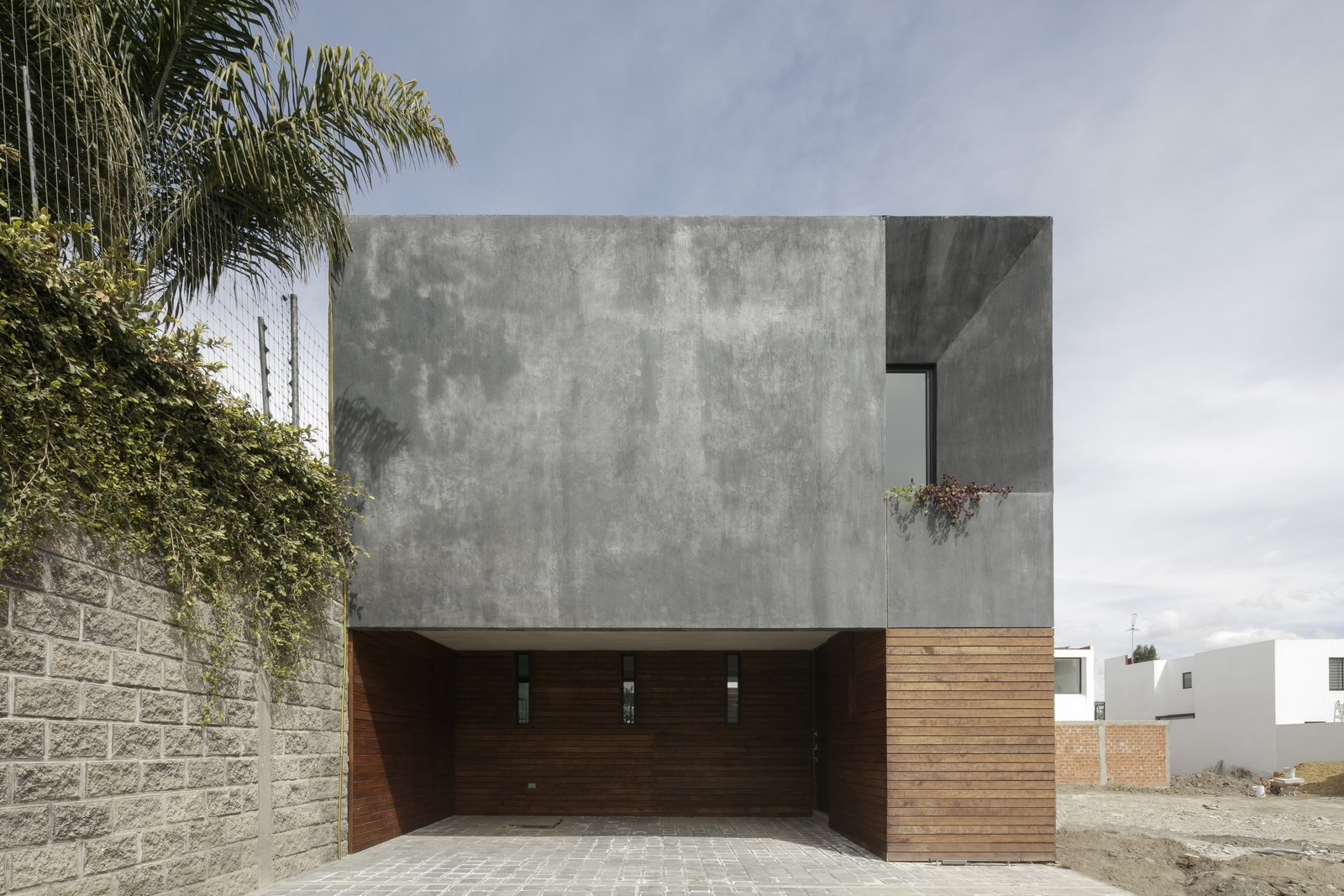 Exterior, Stucco, House, Wood, Concrete, and Green  Best Exterior Wood Green Photos from Casa Once