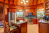 Modern home with Kitchen, Granite Counter, Range, Microwave, Refrigerator, Wood Cabinet, and Ceiling Lighting. Photo 4 of Paradise Found Kapoho Oceanfront Estate