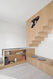 The large furniture even holds the stairs leading up to the attic.