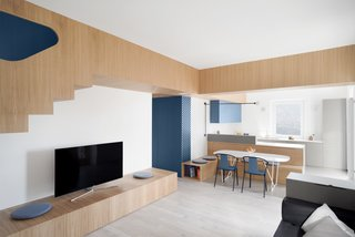 No longer segmented, the main living area of the apartment unites the kitchen and dining alcove as well.