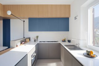 Kitchen cabinets hang from a cross arm.