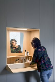 A fold-out vanity tucks away when not in use.