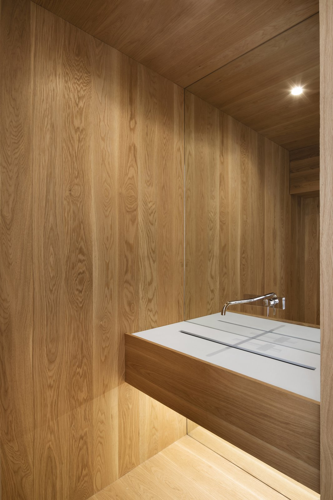Bath Room, Medium Hardwood Floor, One Piece Toilet, Ceiling Lighting, and Undermount Sink  The House on Drolet Street