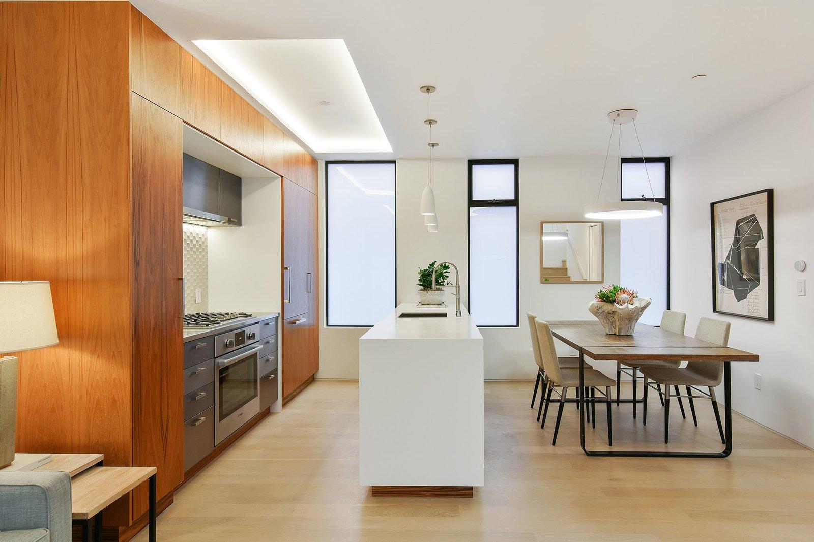 Kitchen, Ceramic Tile Backsplashe, Wood Cabinet, Dishwasher, Microwave, Recessed Lighting, Light Hardwood Floor, Undermount Sink, and Refrigerator  For Sale: 188 Quane Street