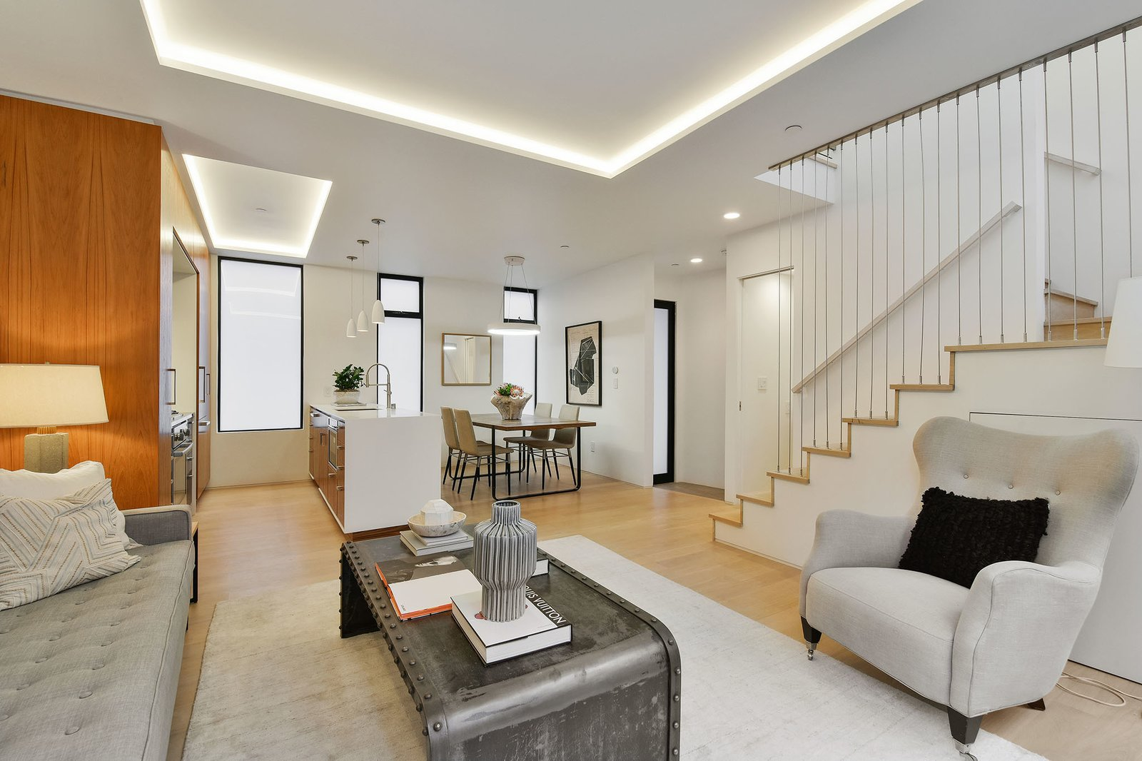 Living Room, Light Hardwood Floor, Ceiling Lighting, and Recessed Lighting  For Sale: 188 Quane Street