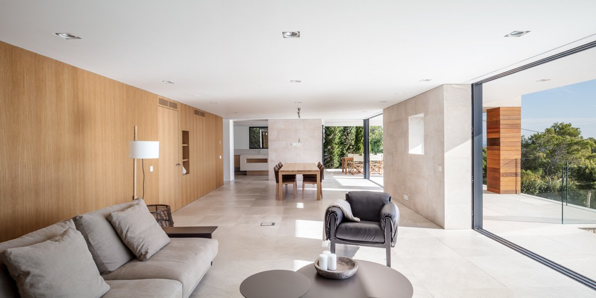 Living Room, Recliner, Chair, Ceiling Lighting, Coffee Tables, Limestone Floor, and Sofa  M14 House by OLARQ Osvaldo Luppi Architects