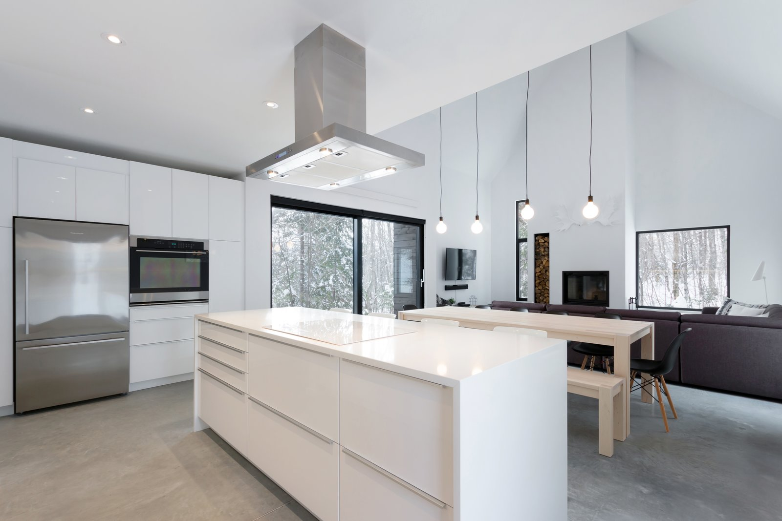 Kitchen, Concrete, Quartzite, Wall Oven, Range Hood, Cooktops, Refrigerator, Ceiling, and White  Kitchen Concrete Refrigerator Quartzite Photos