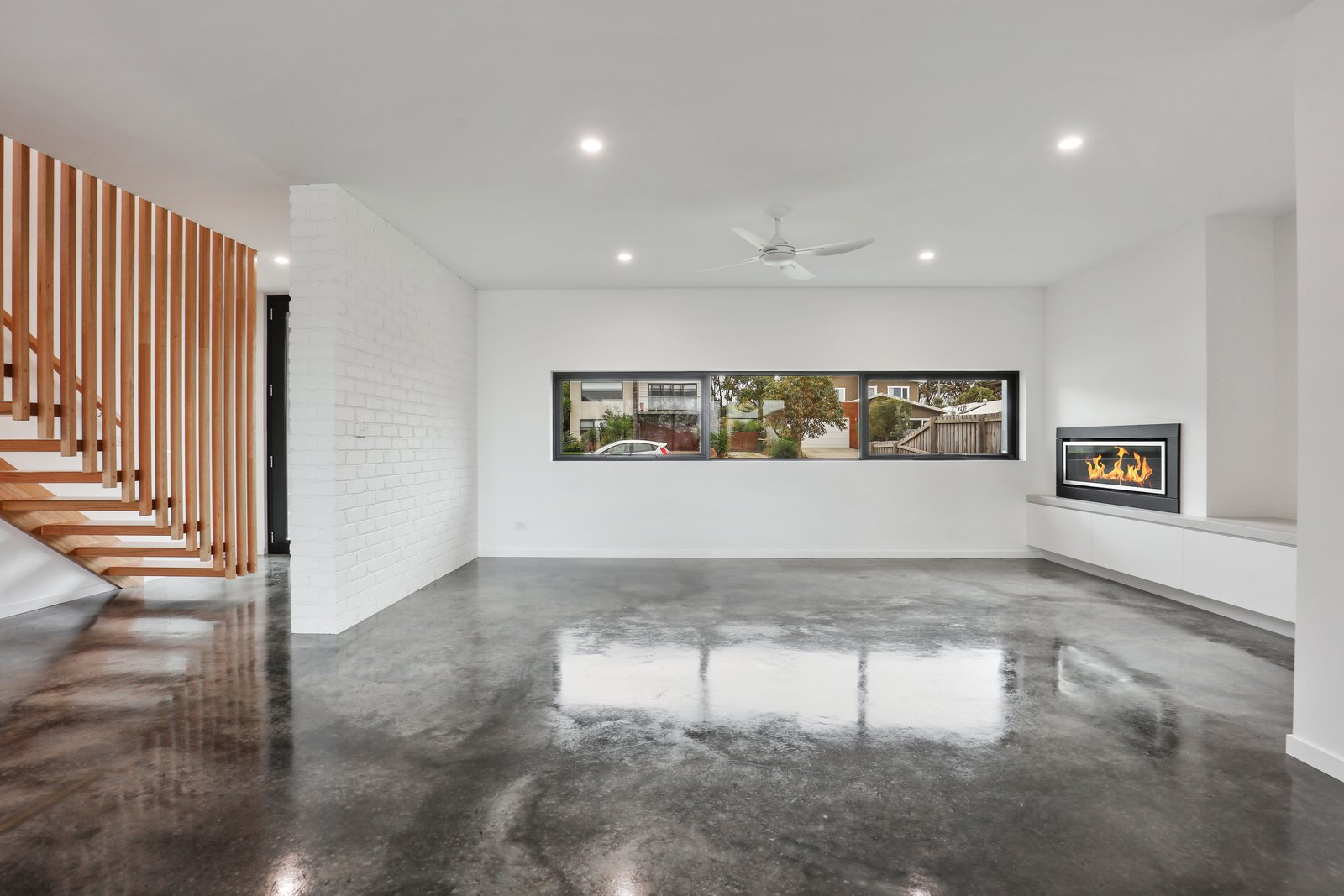 Living Room, Concrete Floor, Gas Burning Fireplace, and Recessed Lighting  Tamara Crecsent by Inverloch 3996