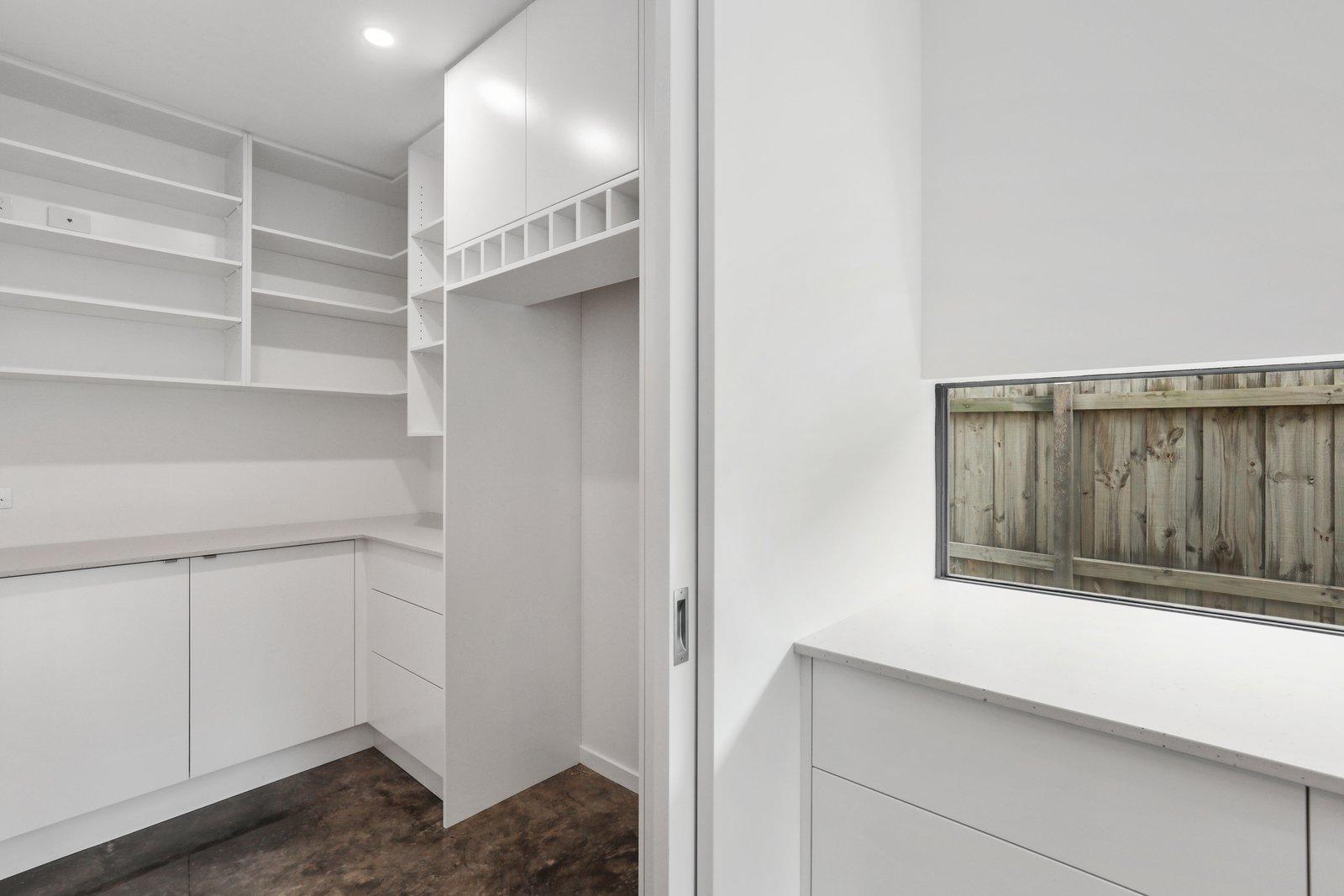 Kitchen, Recessed Lighting, Glass Tile Backsplashe, White Cabinet, Concrete Floor, and Engineered Quartz Counter  Tamara Crecsent by Inverloch 3996
