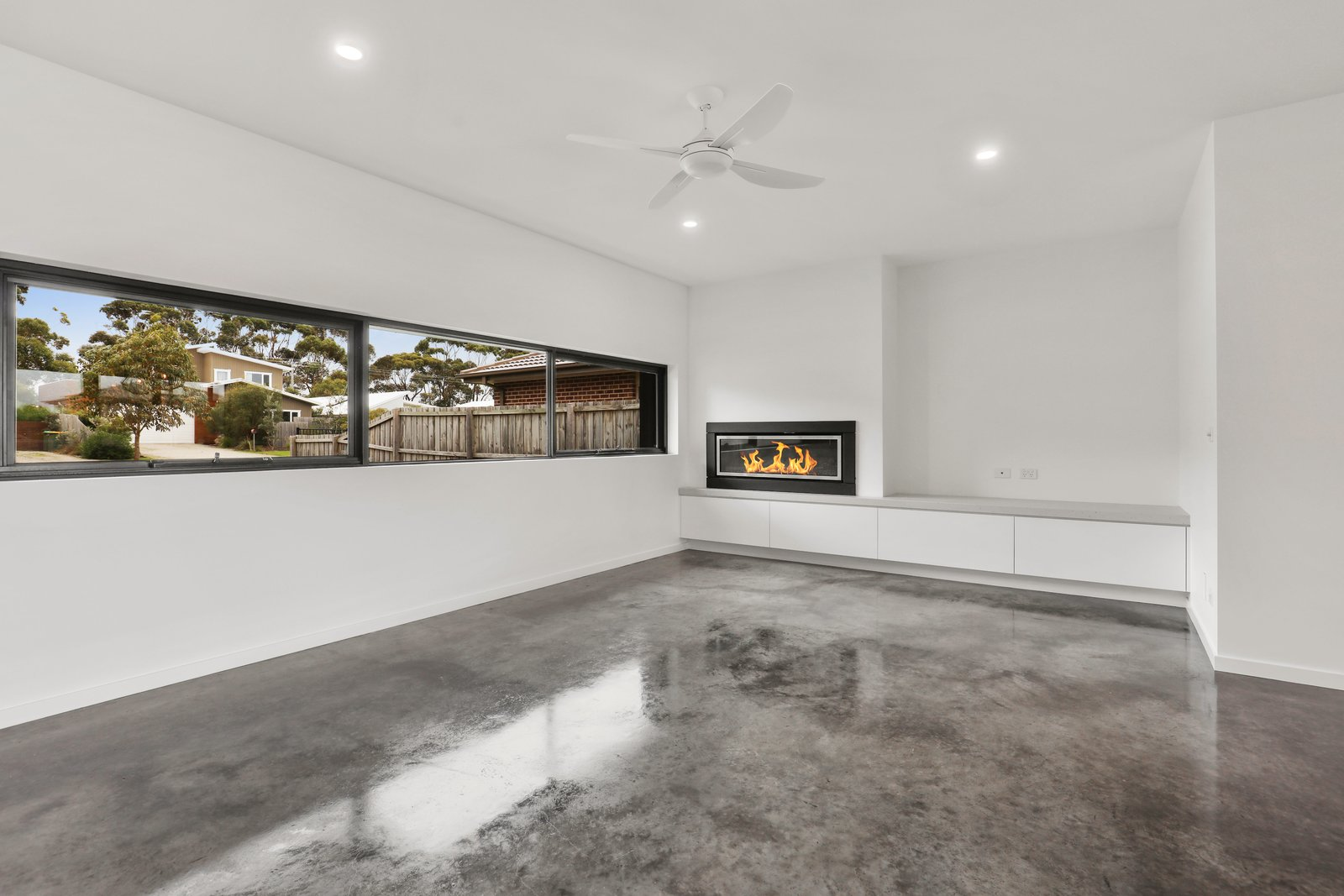 Living Room, Recessed Lighting, Gas Burning Fireplace, and Concrete Floor  Tamara Crecsent by Inverloch 3996