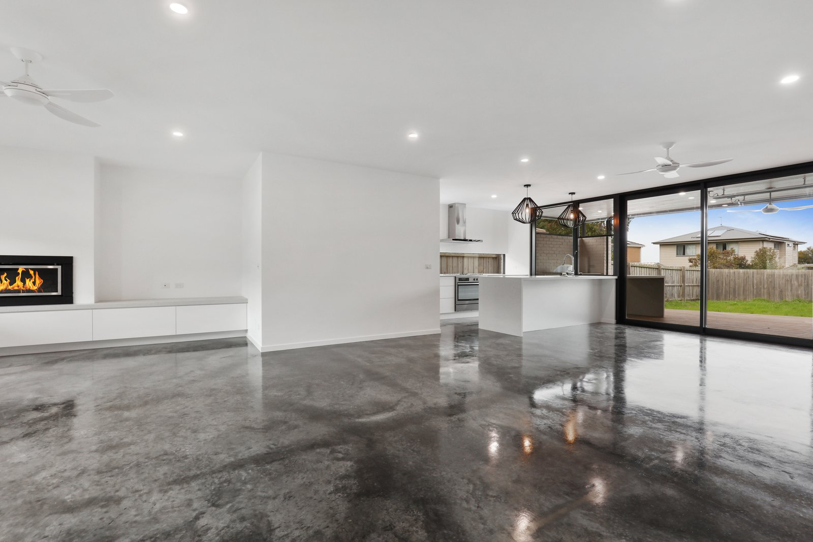 Living Room, Gas Burning Fireplace, Recessed Lighting, and Concrete Floor  Tamara Crecsent by Inverloch 3996