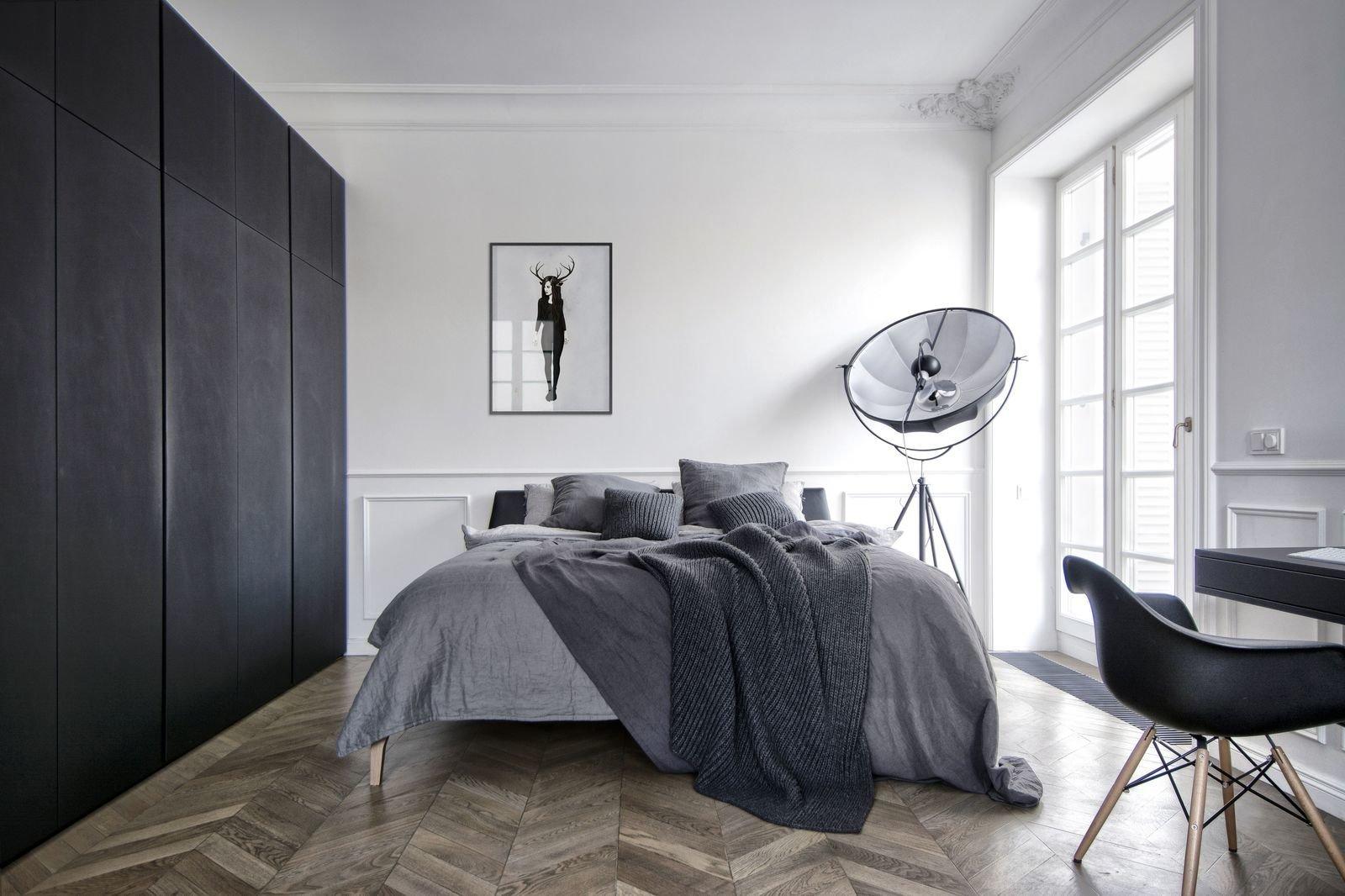 Bedroom, Lamps, Bed, Floor, and Medium Hardwood  Best Bedroom Medium Hardwood Floor Photos from Interior AM