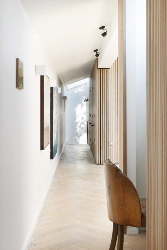 Hallway and Light Hardwood Floor  The Courtyard House by De Rosee Sa