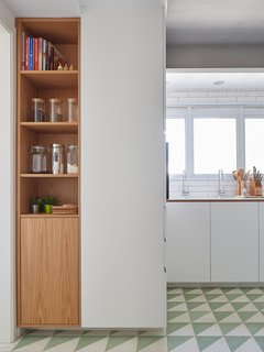 You can still infuse open kitchen shelving into your space without foregoing all cabinetry. For instance, base cabinets typically should maintain their doors, as it's easier to get lower shelves dirty and damage any dishware inside.