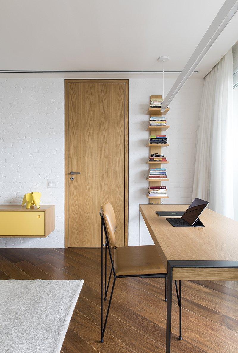 Bedroom, Shelves, Medium Hardwood, Pendant, Chair, and Bookcase  Bedroom Medium Hardwood Pendant Bookcase Photos from CKO Apartment