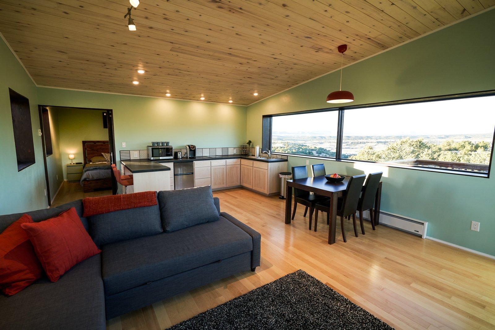 Living Room and Light Hardwood Floor  SkyNest by Joaquin Karcher