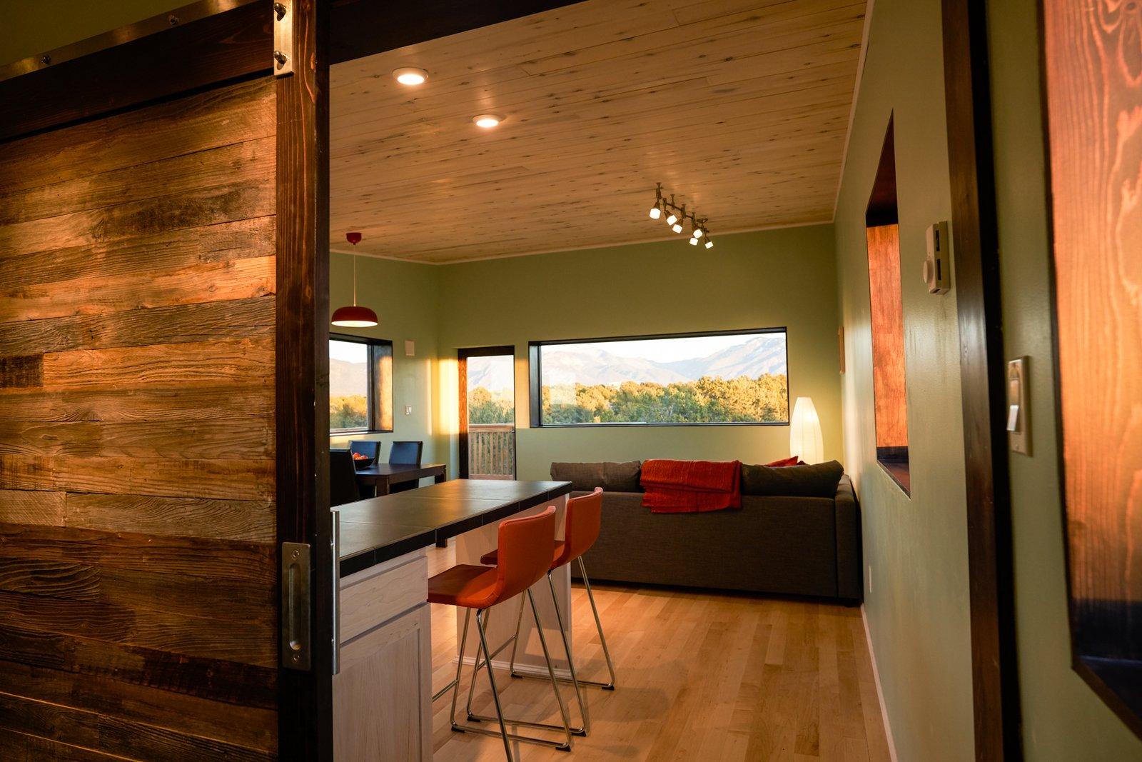 Dining Room and Light Hardwood Floor  SkyNest by Joaquin Karcher