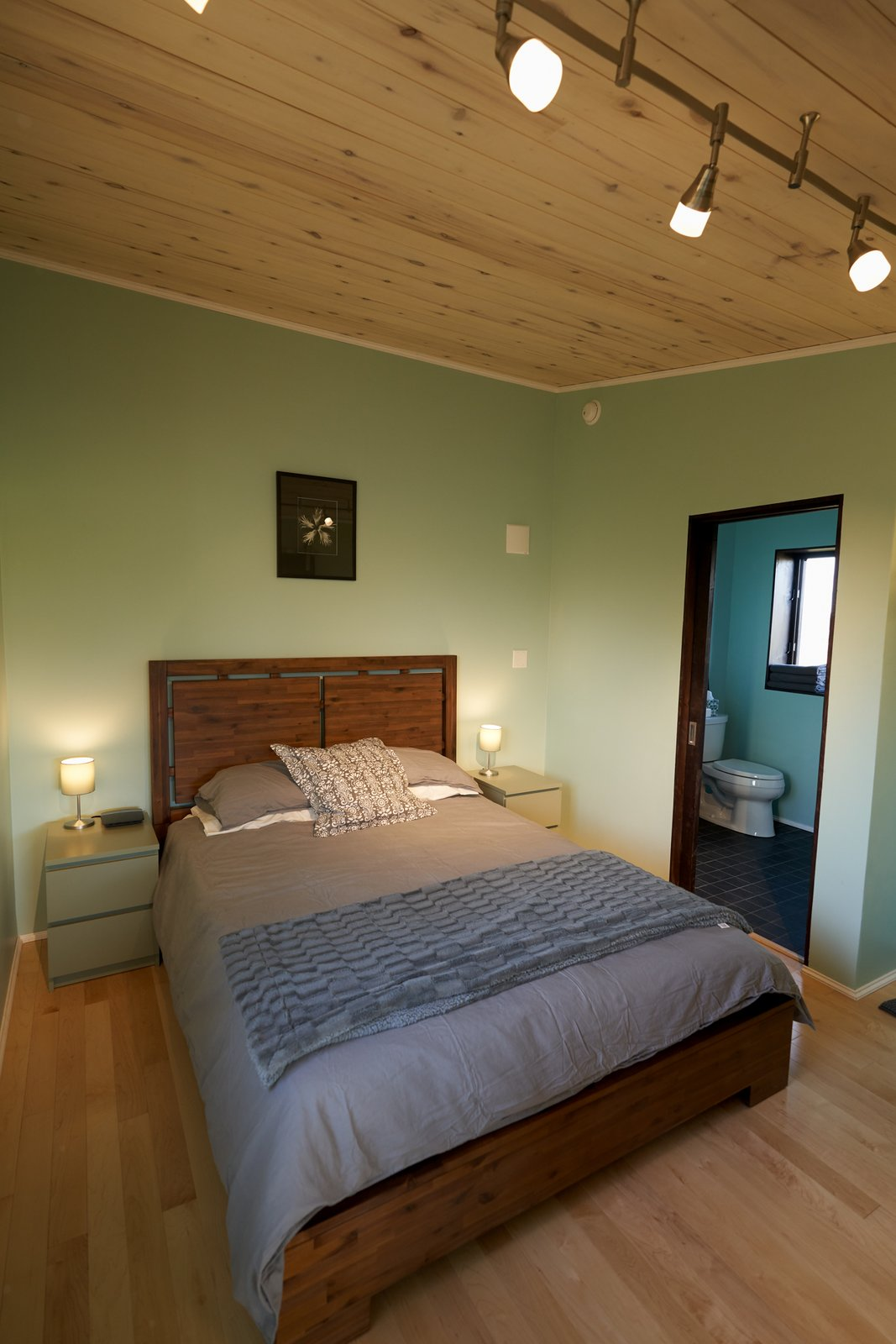 Bedroom, Bed, and Light Hardwood Floor  SkyNest by Joaquin Karcher