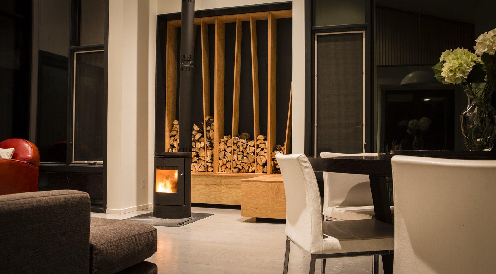 Living Room, Chair, Sectional, Ceiling Lighting, Medium Hardwood Floor, and Wood Burning Fireplace  Pioneer Cabin