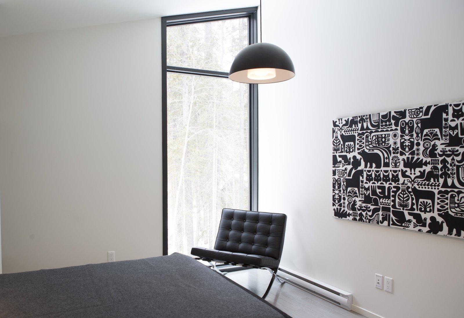 Bedroom, Night Stands, Chair, Ceiling Lighting, Medium Hardwood Floor, and Bed  Pioneer Cabin